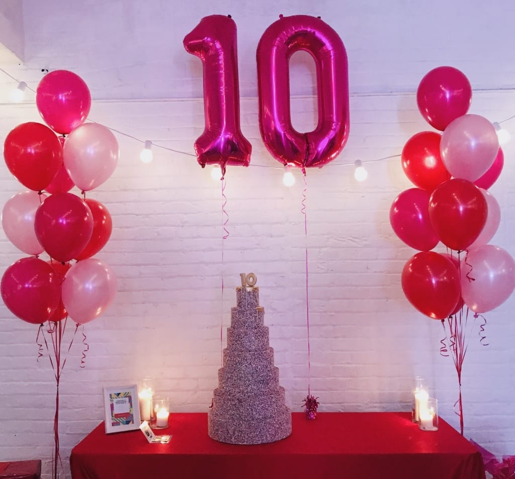 Sprinkle cake & balloons at SheDoesTheCity 10 year event
